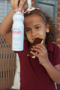 Keeping toddlers clean while running errands presents a challenge for parents. Using Evian facial spray to keep mouths & hands clean is a parent's dream!